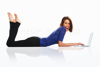 Buy stock photo Surprised or happily astonished by something , Young college student lying on floor with laptop
