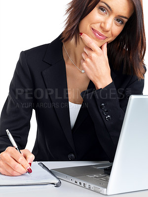 Buy stock photo Portrait of a happy young businesswoman at the office desk writing against white background