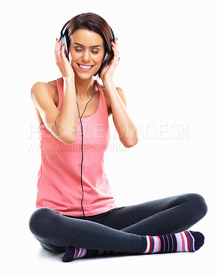 Buy stock photo Relaxed young woman listening to music with eyes closed against white background