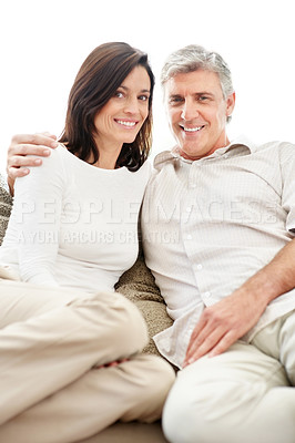 Buy stock photo Portrait of a lovely mature couple sitting together on sofa and smiling