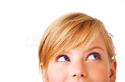 Buy stock photo Close-up portrait of a beautiful teenager. Looking up into the corner. Lots of copyspace and room for text on this isolate.