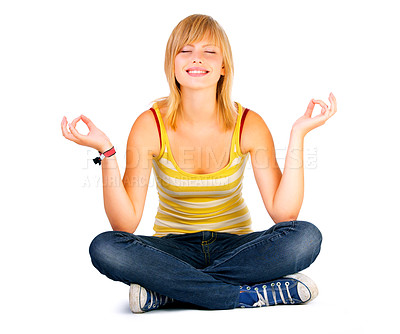 Buy stock photo Yoga on a white background. A young beautiful woman meditating in lotus position. Relaxed, and focused on her inner peace.
