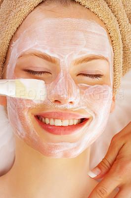 Buy stock photo Shot of a young woman enjoying a healthy skin treatment at a spa resort.