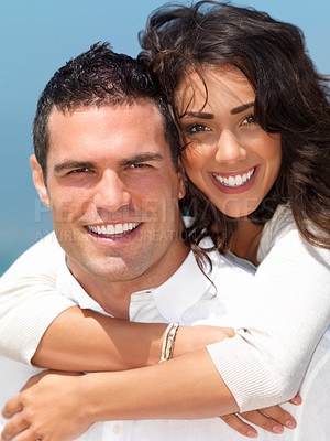 Buy stock photo Close up portrait of a smiling young couple in love outdoors on a bright sunny day