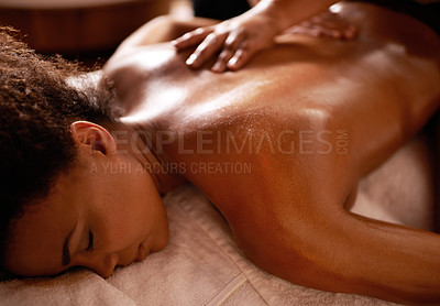 Buy stock photo Shot of a young woman enjoying a massage at a spa