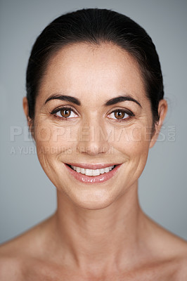 Buy stock photo Cropped studio portrait of a beautiful mature woman smiling