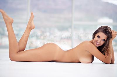 Buy stock photo Shot of a beautiful young woman posing naked