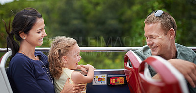 Buy stock photo A young family having a good time on their bus trip