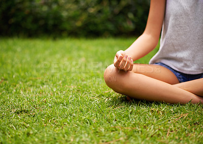 Buy stock photo Cropped shot of a young woman meditating in the garden