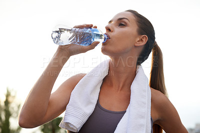 Buy stock photo Shot of an attractive young woman working out