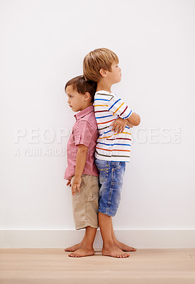 Buy stock photo Two little boys standing back to back