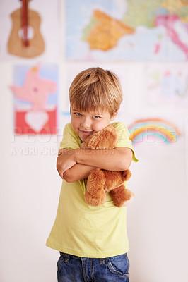 Buy stock photo Portrait of a cute little boy hugging his teddybear