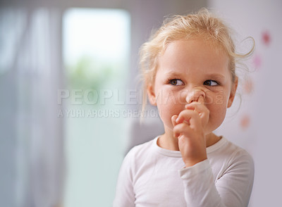 Buy stock photo A little girl picking her nose