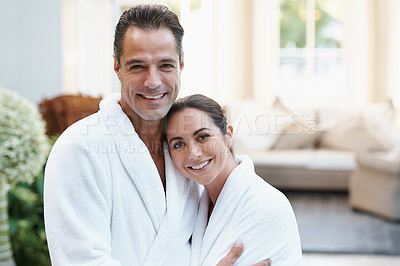 Buy stock photo Shot of a couple in robes at a day spa