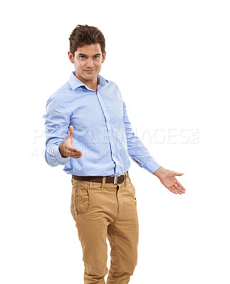 Buy stock photo Portrait of a handsome young man in a studio holding out his hand for a handshake