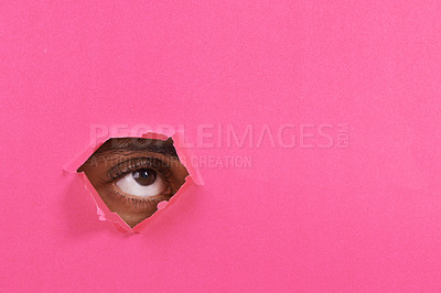 Buy stock photo A view of a man's eye looking through a hole in some colorful paper