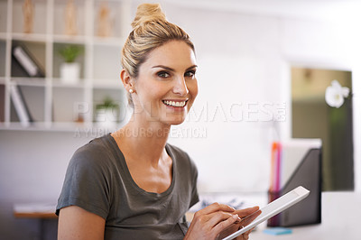 Buy stock photo A beautiful young businesswoman working on a tablet
