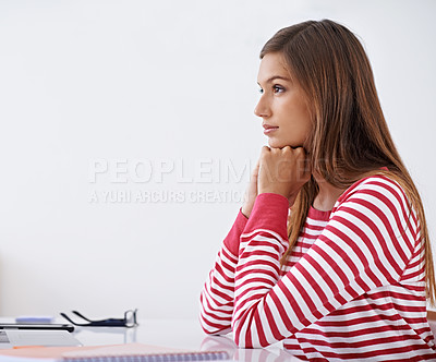 Buy stock photo Profile shot of a young woman sitting at a desk