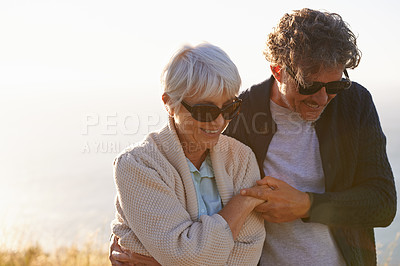 Buy stock photo Cropped view of a senior couple standing on a hillside together