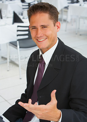 Buy stock photo Portrait of a friendly-lookingyoung businessman gesturing to the camera