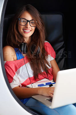 Buy stock photo Portrait of beautiful young girl sitting in an egg chair using laptop