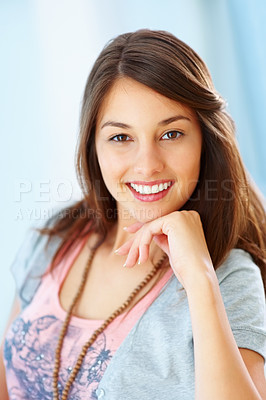 Buy stock photo Portrait of young girl with hand on chin giving you beautiful smile