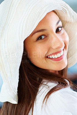 Buy stock photo Closeup of pretty young woman wearing hat and giving you warm smile