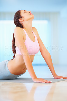 Buy stock photo Young woman in a yoga pose looking ralxed and calm - copyspace