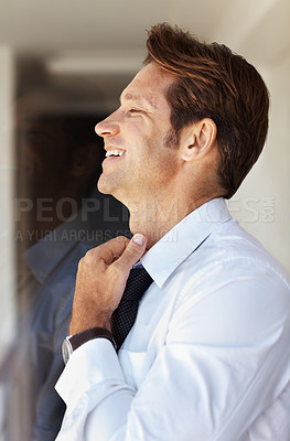 Buy stock photo Portrait of a happy young businessman looking away and smiling