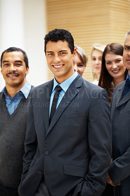 Buy stock photo Focus on businessman with colleagues surrounding him