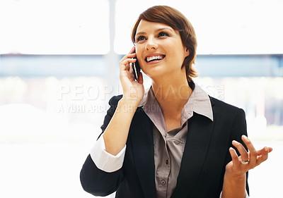 Buy stock photo Female executive having phone conversation