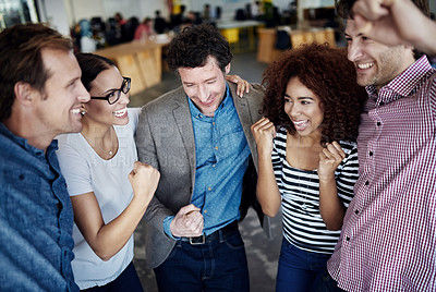 Buy stock photo Shot of a group of coworkers celebrating together while standing in an office