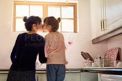 Buy stock photo Cropped shot of a mother and daughter bonding while doing dishes together at home