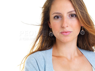 Buy stock photo Closeup portrait of a pretty young woman looking at you against white background