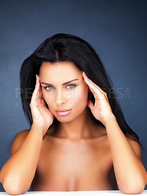 Buy stock photo Topless female model posing on blue background