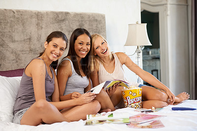 Buy stock photo Portrait of a group of young friends spending quality time together at home