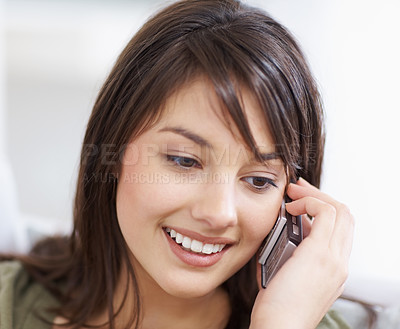 Buy stock photo Closeup of a woman speaking on mobile phon