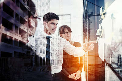 Buy stock photo Shot of a corporate business meeting superimposed over a cityscape