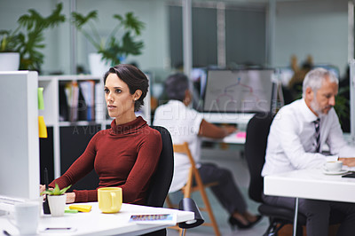 Buy stock photo Shot of a young businesswoman and her colleagues working in their office