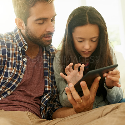 Buy stock photo Shot of a father and daughter using a digital tablet together