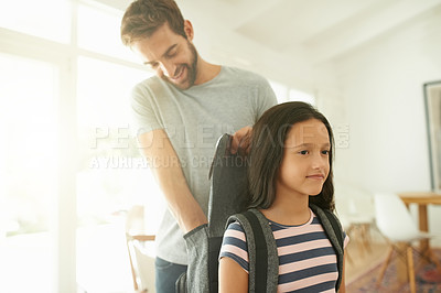 Buy stock photo Shot of a father getting his daughter ready for school