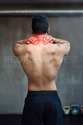 Buy stock photo Rearview shot of an unrecognizable man holding his neck in pain