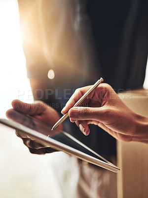 Buy stock photo High angle shot of an unrecognizable woman signing for a home delivery