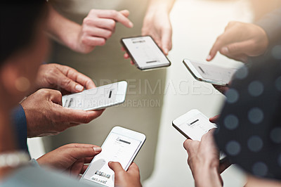 Buy stock photo Cropped shot of a group of unrecognisable businesspeople texting on their cellphones in an office