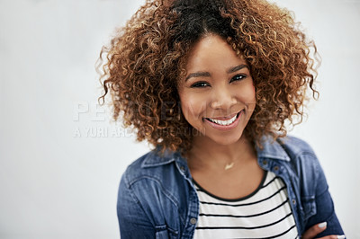 Buy stock photo Portrait of a young woman posing against a white background