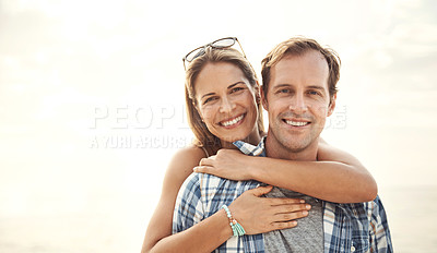 Buy stock photo Portrait of a smiling mature couple embracing at the beach at sunset