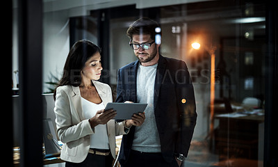 Buy stock photo Shot of colleagues using a digital tablet together at work