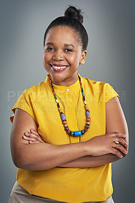 Buy stock photo Studio portrait of a confident and happy woman posing against a gray background