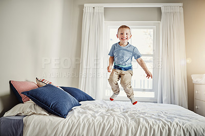 Buy stock photo Full length portrait of a young boy jumping on his bed at home