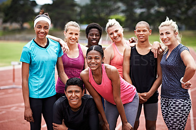 Buy stock photo Portrait of a group of friends in sports clothing standing on a running track